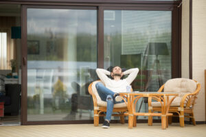 Calm man resting on a balcony chair