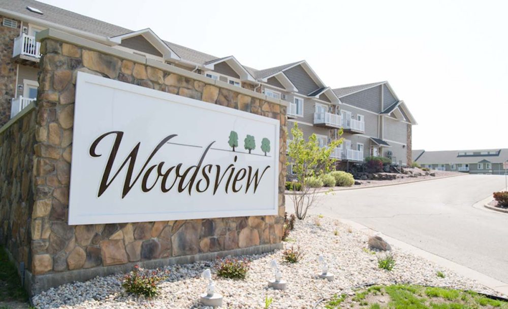 Woodside brick sign welcoming Janesville residents
